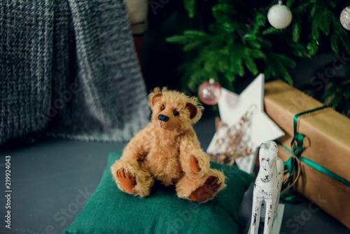 Fototapety, obrazy: gifts under the Christmas tree, toy bear and boxes, the concept of a cozy home new year