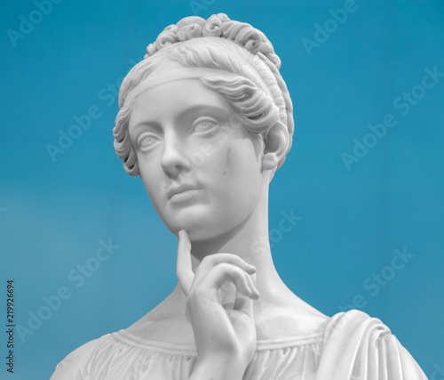 White marble head of young woman Canvas Print