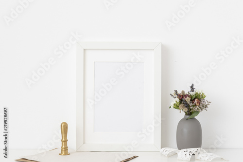 Canvas Prints Textures White a5 portrait frame mockup with dried field wild flowers in vase and gold stamp on white wall background. Template frame for text, lettering, modern art.