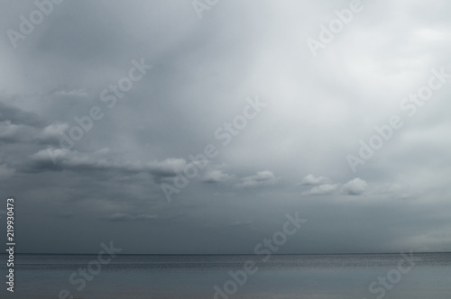 Fotografie, Obraz  Gloomy blue gray sky and clouds over Lake Ladoga