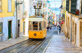 Fototapeta Uliczki - A view of the incline and Bica tram, Lisbon,  Portugal