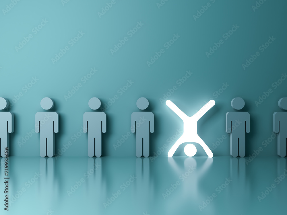 Fototapeta Stand out from the crowd and different creative idea concept One glowing light man standing upside down with arms and legs wide open among other people on dark green background 3D rendering