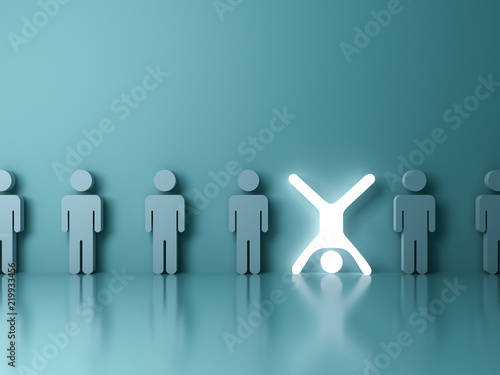 Stand out from the crowd and different creative idea concept One glowing light man standing upside down with arms and legs wide open among other people on dark green background 3D rendering
