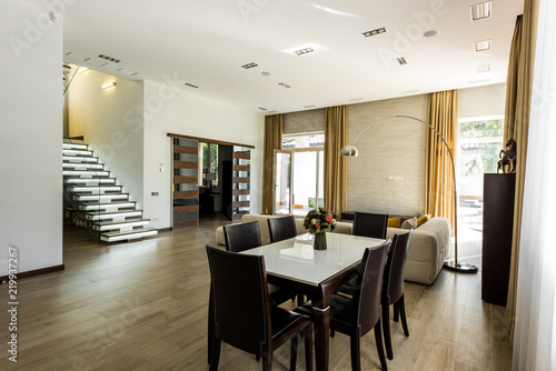 Interior View Of Empty Dining Room With Table Chairs And Stairs Buy This Stock Photo And Explore Similar Images At Adobe Stock Adobe Stock