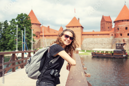 Fototapety, obrazy: Beautiful young woman tourist traveler in the background Trakai castle on the lake, Lithuania sights, travel to the Baltic countries