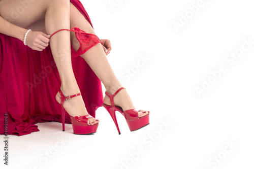 Fotografia  Woman in red dress with sexy legs isolated on white background