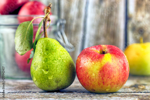 Foto Fresh, real apple and pear from organic farming, ecological harvest on wood background