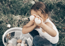 Little Girl Holding And Picking Good Eggs Quality Organic And Bring To The Eye On The Farm. Healthy Foods. Easter.