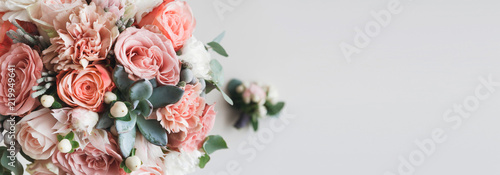 Fotobehang Bloemenwinkel Fresh bunch of pink peonies and roses with copy space