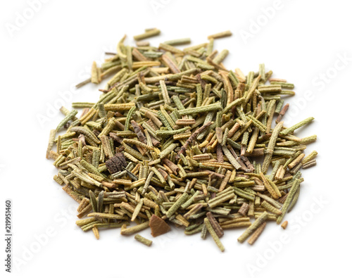 Dry rosemary spice on white. Macro with shallow depth of field.