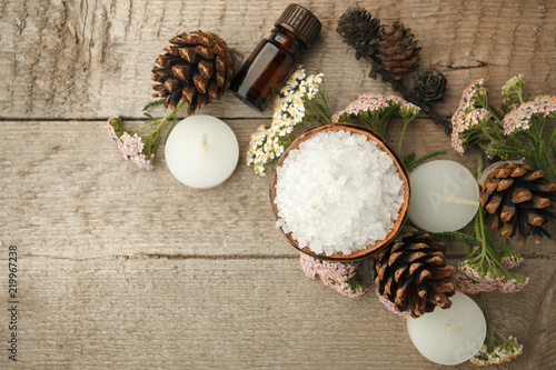 Tuinposter Spa Spa composition on wooden table. Natural aroma oil, sea salt on rustic wooden background. Healthy skin care. SPA concept. Top view with space for text