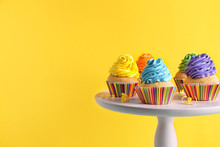 Stand With Delicious Birthday Cupcakes On Color Background