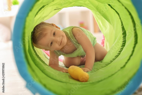Obraz Cute little boy playing with toy tunnel at home - fototapety do salonu