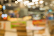 canvas print picture Coffee shop in department store blur background with bokeh. Blurred Interior colorful neon light in coffee shop.
