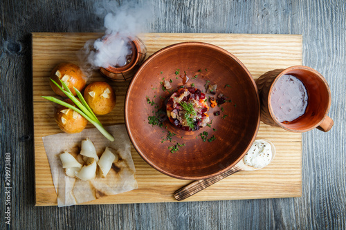 wooden table topped with plates of traditional ukrainian food