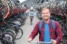 Joyful Blonde Man In Bicycle 3D Parking Lot