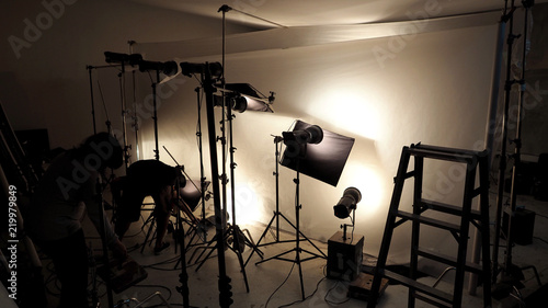 Fototapeta Lighting setup in studio for commercial works such as photo movie or video film production which use many LED light more than 1000 watts with big softbox snoot reflector umbrella and tripods.  obraz na płótnie