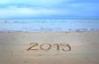 New Year 2019 written on the beach sand