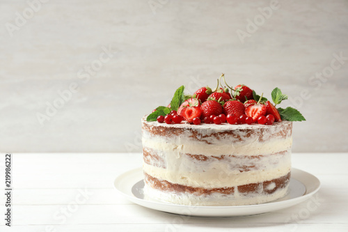 Delicious homemade cake with fresh berries and space for text on wooden table