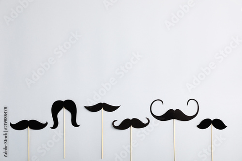 Obraz Flat lay composition with paper moustaches and space for text on gray background. Happy Father's Day - fototapety do salonu
