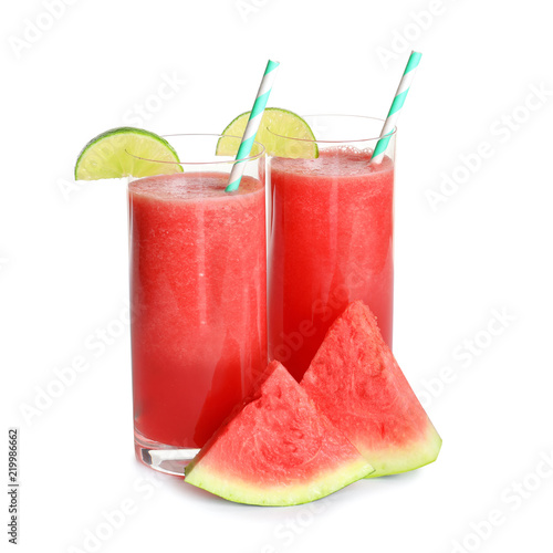 Tasty summer watermelon drink in glasses and slices of fresh fruit on white background