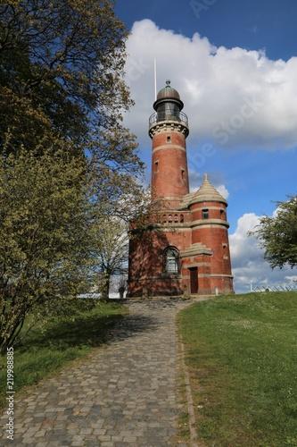 Foto  idyllischer Backstein Leuchtturm am Tiessenkai