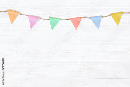 Festive white wooden background with garland