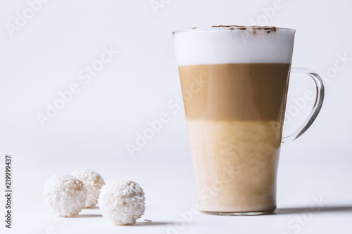 Fotografiet coffee latte with dessert on a white background