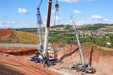 Crane Lifting A Bridge Beam