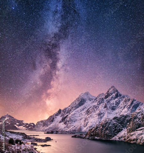 Foto auf Gartenposter Gebirge Mountans and reflection on the water surface at the night time. Sea bay and mountains at the night time. Milky way above mountains, Norway. Beautiful natural landscape in the Norway