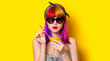 canvas print picture - Young girl with purple hair holding lemonade cocktail on yellow background