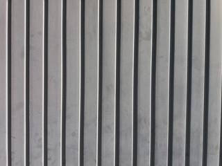 Striped black metal wall texture