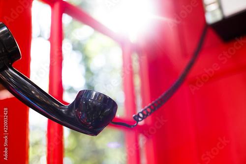Fotografie, Tablou  black handset in the red booth