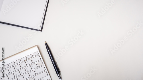 Photo  Office desk table with notebook,keyboard and pen Top view on white background