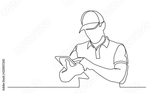 Fototapeta continuous line drawing of standing delivery guy filling order on tablet obraz