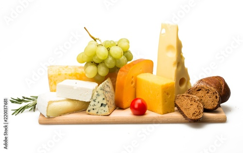 Various Kinds of Cheeses, Cherry Tomatoe, Grape and Bread on the