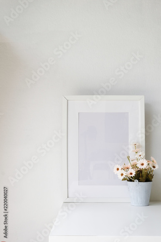 Canvas Prints Textures Photo frame and flower on table with copy space.