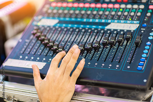 Blur Photo Hand adjusting audio mixer  sound engineer hands