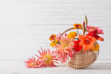 Summer Flowers In Basket On Wo...