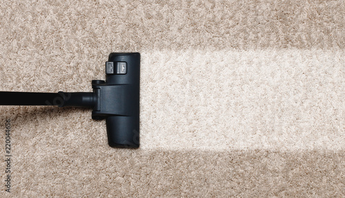 Photo Cleaning white with pile carpet vacuuming at home