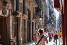 Busy Street Near Gothic Quarter Shopping Area In Barcelona