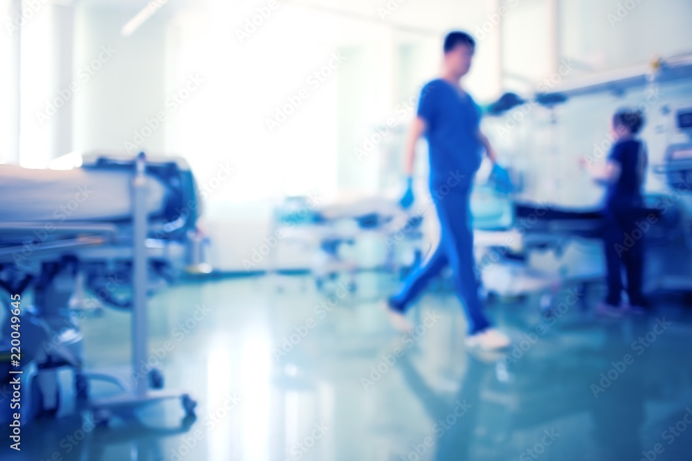 Fototapeta Working medical staff in the bright intensive care unit, unfocused background