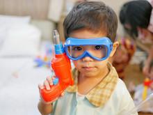 Little Asian Baby Wearing Tech...