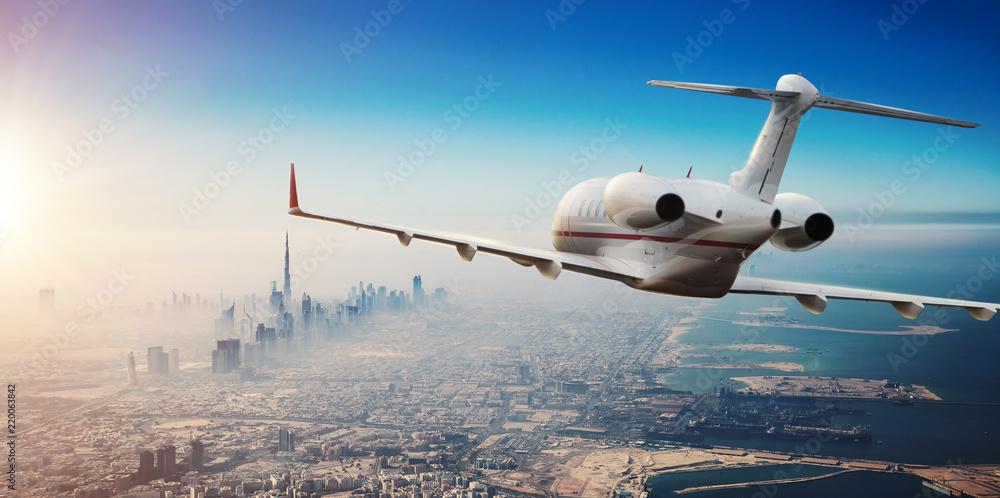 Fototapety, obrazy: Luxury private jetliner flying above Dubai city, UAE.