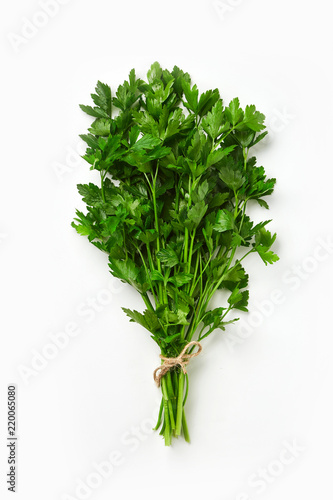 Valokuvatapetti A bunch of parsley isolated on white background