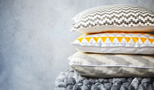 Yellow And Grey Pillows On The...
