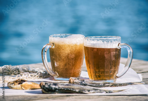 Tuinposter Bier / Cider Beer in mugs and dried fish