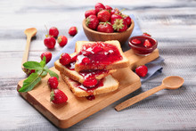 Composition With Slices Of Bread And Delicious Strawberry Jam On Wooden Table