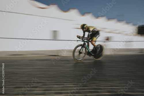 Foto op Plexiglas Fietsen Cyclist going fast during first stage of tour of Spain cycling race.