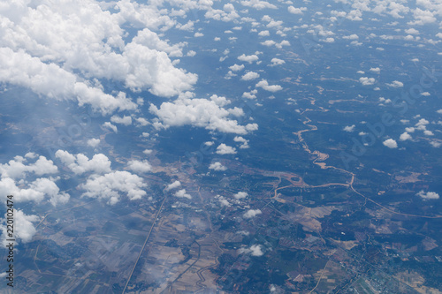 Foto op Aluminium Luchtfoto Aerial view from airplane window with forest and river